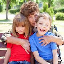 Grandmother with two grandchildren - Senior Assistance Center providing for them